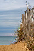 Sandfence and seaoats on a cloudy winters day at the Outer Banks of NC.