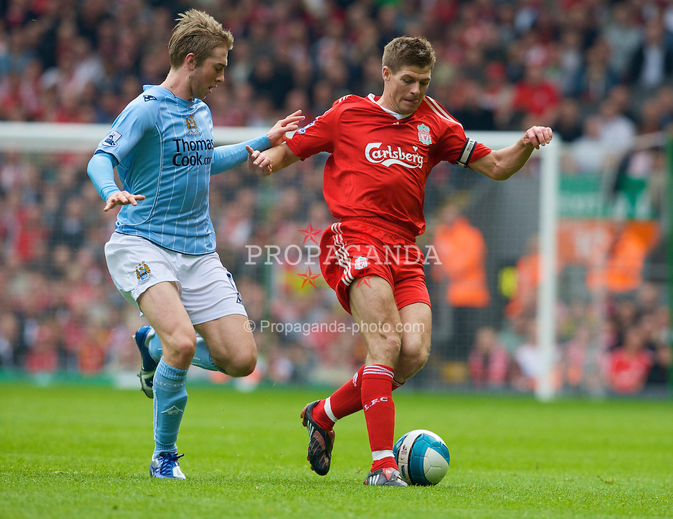 LIVERPOOL, ENGLAND - Sunday, May 4, 2008: Liverpool's captain Steven Gerrard MBE and Manchester City's Michael Johnson during the Premiership match at Anfield. (Photo by David Rawcliffe/Propaganda)
