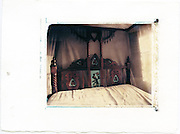 Typical Lamu wooden bed with embedded glass painting.<br />