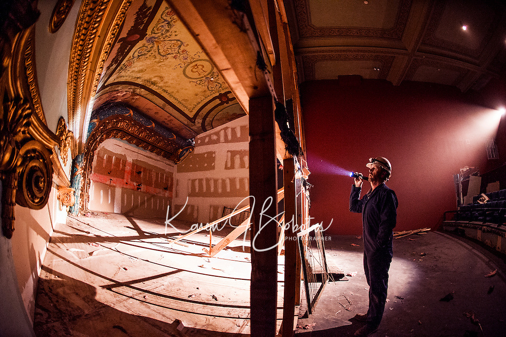 During our construction tour Superintendant Bob Ferguson from Bonnette, Page and Stone shines his flashlight to into the upper balcony stage area of the Colonial Theater in downtown Laconia.  (Karen Bobotas/for the Laconia Daily Sun)