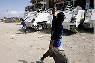 Haitians yell at U.N. troops as they pass a United NAtions compound at a in a rally in the Cite-Soliel neighborhood of Port-Au-Prince, Haiti February 1, 2006. Demonstrators were protesting the United Nations' plans to have voting stations for voters outside of Cite-Soliel due to security concerns...Photo by Keith Bedford
