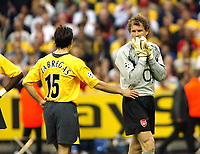 Photo: Chris Ratcliffe.<br /> Arsenal v Barcelona. UEFA Champions League Final. 17/05/2006.<br /> Jens Lehmann is consolded by Cesc Fabregas