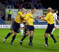 Photo: Richard Lane.<br />Oxford United v Carlisle United. Nationwide Division Three. 13/12/2003.<br />Andy Crosby celebrates scoring Oxford's second goal with Steve Basham and Matt Robinson.