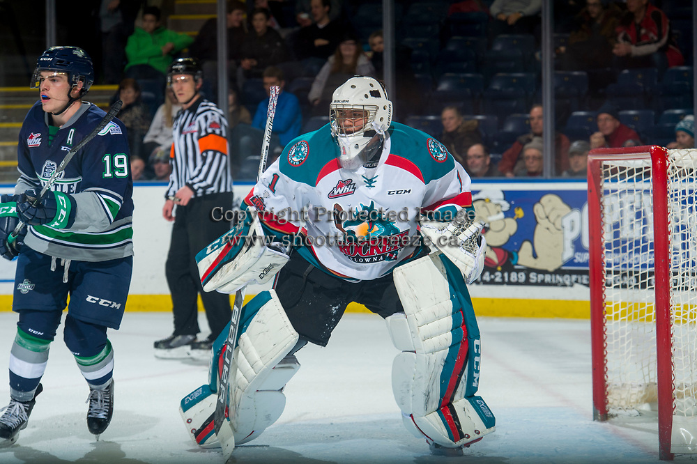 KELOWNA, CANADA - JANUARY 5: Donovan Neuls #19 of the Seattle Thunderbirds looks for the pass in front of the net of James Porter #1 of the Kelowna Rockets on January 5, 2017 at Prospera Place in Kelowna, British Columbia, Canada.  (Photo by Marissa Baecker/Shoot the Breeze)  *** Local Caption ***