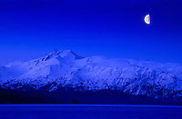 Moon over Gunsight Mountain of the Kenai Mountains.  viewed from Homer, Alaska.