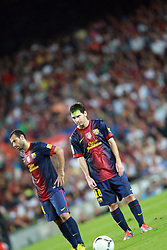 Lionel Messi of Barcelona is lasered by a green light as he prepares to take a freee kick. Barcelona v Real Madrid, Supercopa first leg, Camp Nou, Barcelona, 23rd August 2012...Credit : Eoin Mundow/Cleva Media