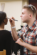 PROVIDENCE, RI - FEB 13: Jake Blanchette does Muhsinah Muhammad's makeup backstage prior to the Stetkewicz show as part of StyleWeek NorthEast on February 13, 2015 in Providence, Rhode Island. (Photo by Cat Laine)