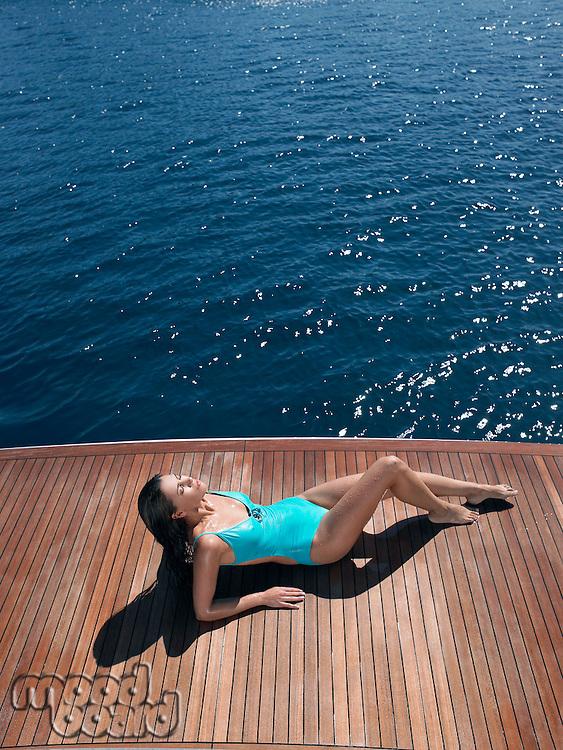 Woman Sunbathing on Yacht