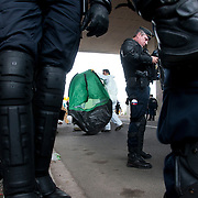 France , Calais, camp for refugees known as 'The Jungle'. September 21st 2015. French police oversee the removal of the tents and belongings in them, from under the flyover at the edge of the camp.