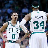 18 March 2013: Boston Celtics point guard Avery Bradley (0) talks to Boston Celtics small forward Paul Pierce (34) during the Miami Heat 105-103 victory over the Boston Celtics at the TD Garden, Boston, Massachusetts, USA.