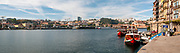 Douro River panorama with a partial view of Porto (right), and Vila Nova de Gaia (left), from Ribiera Square pier, Porto, Portugal.