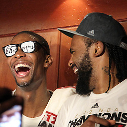 Jun 21, 2012; Miami, FL, USA; Miami Heat power forward Chris Bosh (left) and center Ronny Turiaf (right) celebrate in the locker room after winning the 2012 NBA championship at the American Airlines Arena. Miami won 121-106. Mandatory Credit: Derick E. Hingle-US PRESSWIRE