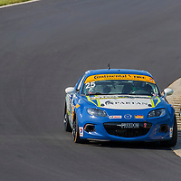 Alton, VA - Aug 26, 2016:  The Freedom Autosport Mazda MX-5 races through the turns at the Oak Tree Grand Prix at Virginia International Raceway in Alton, VA.