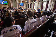 Supporters wear T-shirts with 15 & ENFORCE in back as the Los Angeles City Council votes to raise the minimum wage $15 per hour by 2020, in Los Angeles, California, on Tuesday, May 19, 2015. The council voted 14-1 in favor of raising the minimum wage. Under the plan, the wage will increase incrementally beginning in July 2016, eventually reaching $15 an hour by 2020 for employers with 26 or more workers, with a one- year delay for smaller businesses.(Photo by Ringo Chiu/PHOTOFORMULA.com)