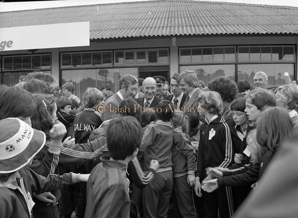 President Hillery at The Community Games..1979..15.09.1979..09.15.1979..15th September 1979..President Patrick Hillery attended the opening of The National Community Games finals at Mosney, Co Meath today. The finals were held in the grounds of The Butlins Holiday Centre and were sponsored by Tayto Irl Ltd,Greencastle Road,Coolock,Dublin..Image shows President Hillery being mobbed by the children taking part in the Community Games.
