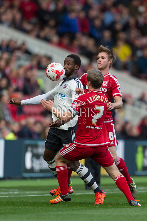 Fulham striker Moussa Dembele holds the ball from Middlesbrough FC midfielder Grant Leadbitter and Middlesbrough FC defender Tomas Kalas  during the Sky Bet Championship match between Middlesbrough and Fulham at the Riverside Stadium, Middlesbrough, England on 17 October 2015. Photo by George Ledger.