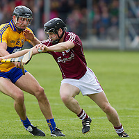 Galway's Davy Glennon bursts past Clare's Cathal Moore