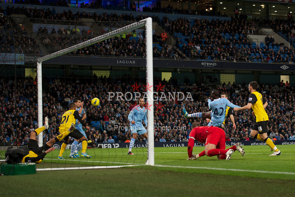 MANCHESTER, ENGLAND - Saturday, February 25, 2012: Manchester City's Yaya Toure in action against Blackburn Rovers during the Premiership match at City of Manchester Stadium. (Pic by David Rawcliffe/Propaganda)