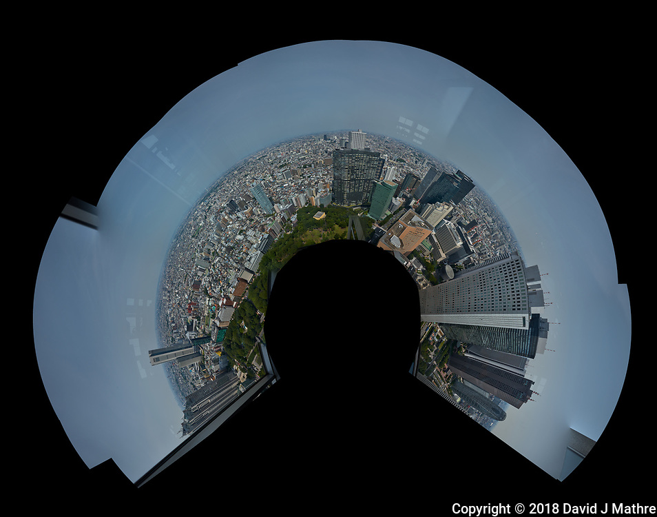 Little Planet View (270 degrees) of the Tokyo Skyline from the 47th floor North Tower Observatory in the Metropolitan Government Building. Composite of 42 images taken with a Leica CL camera and 18 mm f/2.8 lens (ISO 100, 18 mm, f/2.8, 1/2000 sec). Raw images processed with Capture One Pro and AutoPano Giga Pro.