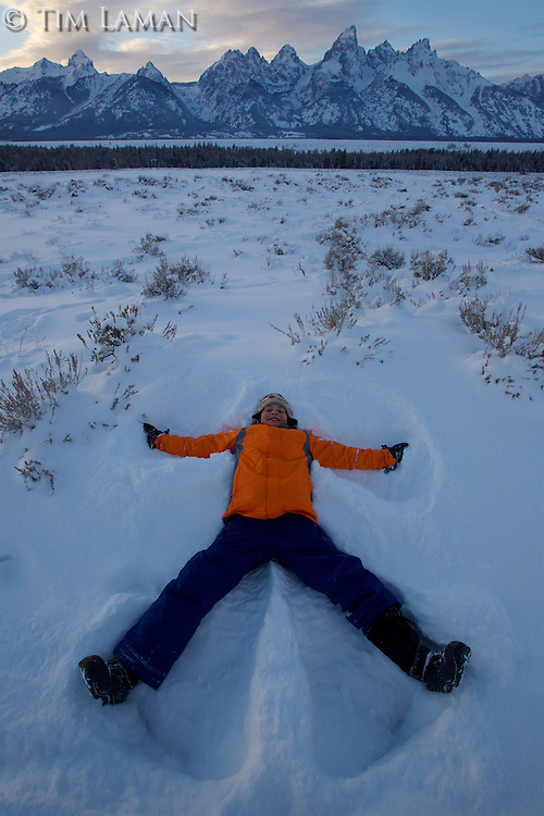 Russell Laman (age 12) makes a snow angel below the Tetons.<br />