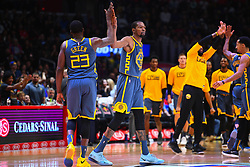 November 13, 2018 - Los Angeles, CA, U.S. - LOS ANGELES, CA - NOVEMBER 12: Golden State Warriors Forward Draymond Green (23) gives Golden State Warriors Forward Kevin Durant (35) a high five during a NBA game between the Golden State Warriors and the Los Angeles Clippers on November 12, 2018 at STAPLES Center in Los Angeles, CA. (Photo by Brian Rothmuller/Icon Sportswire) (Credit Image: © Brian Rothmuller/Icon SMI via ZUMA Press)