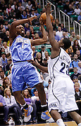 Denver Nuggets guard Chauncey Billups (1) is blocked by Utah Jazz guard Wesley Matthews, (23) as he attempts to pass off the ball during the first half of Game 6 of the NBA Western Conference first-round playoff series in Salt Lake City, Friday, April 30, 2010. (AP Photo/Colin E Braley)