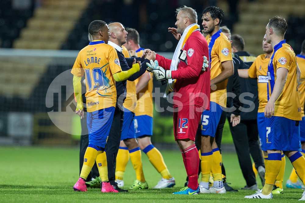 Adam Murray celebrates with Brian Jensen and teammates after his Mansfield Town side run out 2-0 winners during the Sky Bet League 2 match between Notts County and Mansfield Town at Meadow Lane, Nottingham, England on 14 August 2015. Photo by James Williamson.