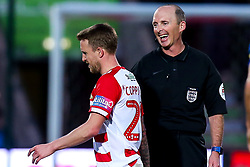James Coppinger of Doncaster Rovers walks past referee Mike Dean - Mandatory by-line: Robbie Stephenson/JMP - 17/02/2019 - FOOTBALL - The Keepmoat Stadium - Doncaster, England - Doncaster Rovers v Crystal Palace - Emirates FA Cup fifth round proper