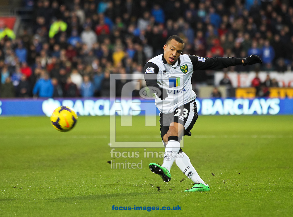 Picture by Tom Smith/Focus Images Ltd 07545141164<br /> 01/02/2014<br /> Martin Olsson of Norwich City crosses the ball during the Barclays Premier League match at the Cardiff City Stadium, Cardiff.