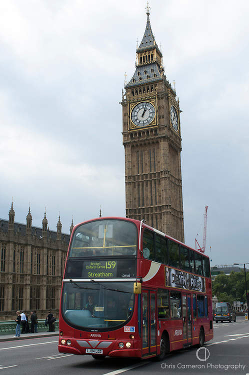 A double decker bus passes Westminster. London, United Kingdom.
