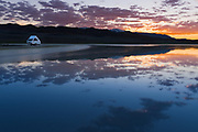 Aliner camping at Sunset in the Black Rock desert, Nevada, home of Burning Man filled with water at the end of May, 2017. Black Rock Lake, NV, USA, Gerlach.