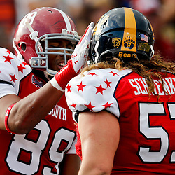 Jan 26, 2013; Mobile, AL, USA;  Senior Bowl south squad tight end Michael Williams of Alabama (89 celebrates with ol Brian Schwenke of Cal (57) during the first half of the Senior Bowl against the Senior Bowl north squad at Ladd-Peebles Stadium. Mandatory Credit: Derick E. Hingle-USA TODAY Sports
