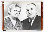 photo album with on top a large vintage photo elderly couple portrait France