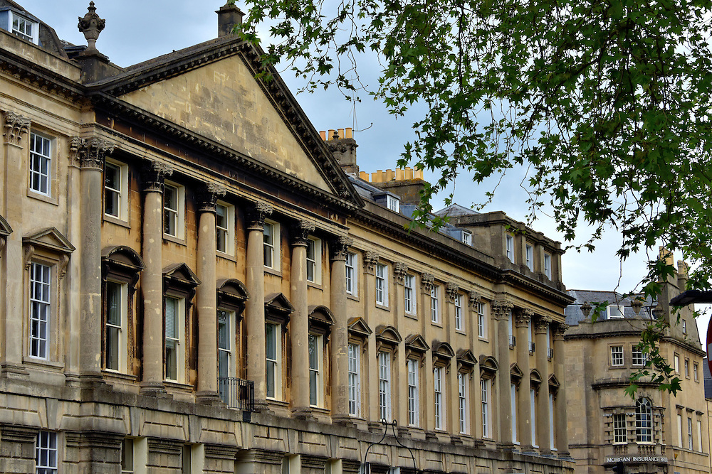 World War II Damages in Bath, England<br /> As Bath lost its appeal as a spa destination during the second half of the 19th century, the town lost its motivation to maintain its legacy architecture. That trend was partially reversed when the Bath Preservation Trust was established in 1934. Then World War II broke out. During the Baedeker Blitz of April, 1942, Luftwaffe air raids destroyed over 300 buildings. By the end of the war, the city demolished more than 1,000. To Bath&rsquo;s credit, they typically rebuilt in the Georgian era, classical styles that had become their trademark. This is the Bath Academy of English.  Across the street is Queen Square where a 1,100 pound bomb exploded during the Bath Blitz.