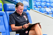 Reading goalkeeping coach Dave Beasant reading a newspaper before the EFL Sky Bet Championship match between Reading and Derby County at the Madejski Stadium, Reading, England on 3 August 2018. Picture by Graham Hunt.