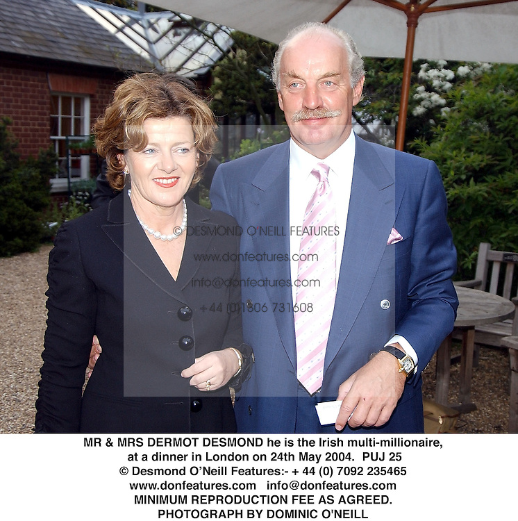 MR & MRS DERMOT DESMOND he is the Irish multi-millionaire, at a dinner in London on 24th May 2004.PUJ 25