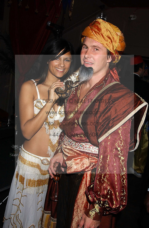 ARUNA SHIELDS and JULIAN INGALL at a party to celebrate the recent merger of Chelsea Mortgage Management with Cobalt Capital - A Night in Marrakesh held at Raffles, nightclub, Kings Road, London on 1st December 2005.<br />
