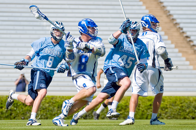 26 April 2009:Duke junior attackman #8 Max Quinzani looks to pass while beinng guarded by UNC freshman  #45 Charlie McComas and junior defenseman #8 Michael Jarvis..