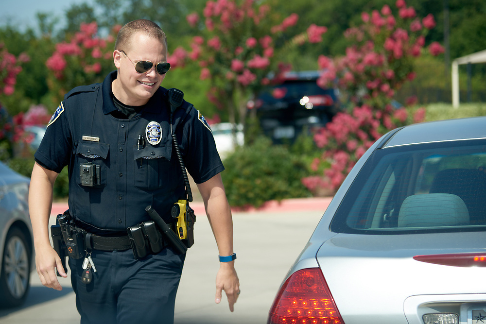 """Officer Brad Uptmore of the Southlake Police Department patrols the streets in Southlake, Texas on June 23, 2017. """"CREDIT: Cooper Neill for The Wall Street Journal""""<br /> Police"""