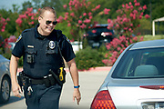 Officer Brad Uptmore of the Southlake Police Department patrols the streets in Southlake, Texas on June 23, 2017. &quot;CREDIT: Cooper Neill for The Wall Street Journal&quot;<br /> Police