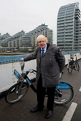 © Licensed to London News Pictures.13/12/2013. London, UK. Mayor of London, Boris Johnson arrives to launch the south west expansion of the Barclays Cycle Hire into Hammersmith & Fulham and Wandsworth.Photo credit : Peter Kollanyi/LNP