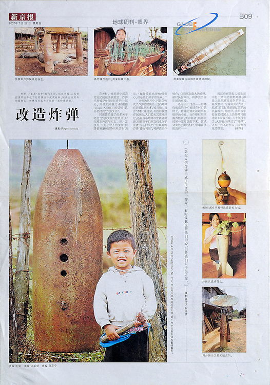 """The Beijing News - page featuring US weapons converted to other uses like planters, boats and satelite dishes.   The USA dropped more than 2 million tons of bombs on Laos during the """"Secret War"""" in Laos, which was waged as part of America's involvement in Vietnam.  The large picture is of a boy with a hammer standing next to a bomb bell used to call meetings in his village in Xieng Khouang Province.  The bomb bell is made from a US 750 lb Mk-117 bomb."""