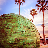 Green Globe at Newport Beach Pier picture. The bronze green globe sculpture is located at the entrance of Newport Pier and says Everyone is Welcome at the Beach.