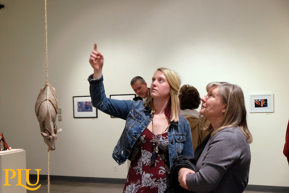 Sarah Henderson talks about her sculpture selected as the top piece in the juried student art show opening in Ingram Gallery on Wednesday, Nov. 18, 2015. (Photo: John Froschauer/PLU)