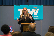 Wyandanch, New York, USA. March 26, 2017. SUE MOLLER. an administrator of TWW LI, is introducing a speaker at Politics 101 event, the first in a series of activist training workshop for members of TWW LI, the Long Island affiliate of national Together We Will. An audience member is taking cell phone photo. One speaker referred to groups such as TWWLI as activist pop-up groups.