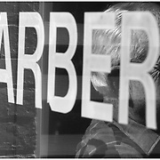 James Paige sits down in between customers at his barber shop on Dickinson Avenue.
