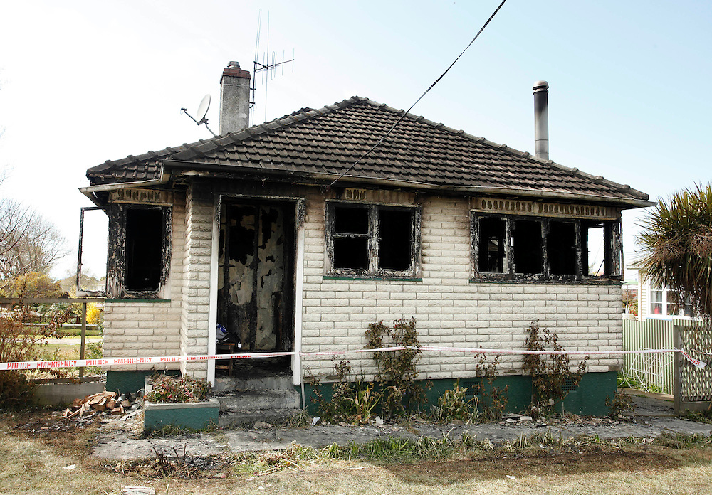 A man and an infant were hospitalised after this housefire on Saturday, in Bouverie St, Timaru, , New Zealand, Sunday, October 09, 2011.  Credit:SNPA / Pam Johnson