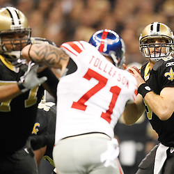 November 28, 2011; New Orleans, LA, USA; New Orleans Saints quarterback Drew Brees (9) passes against the New York Giants during the first quarter of a game at the Mercedes-Benz Superdome. Mandatory Credit: Derick E. Hingle-US PRESSWIRE