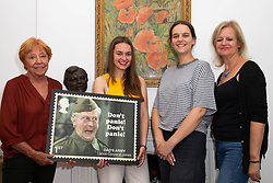 L-R Clive Dunn's widow Priscilla Morgan, grand daughters Alice and Lydia and daughter Jessica admire a stamp design featuring Dad's Army's Clive Dunn. London, June 04 2018.