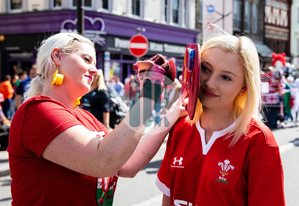 A Wales fans having face paint applied<br /> <br /> Photographer Simon King/Replay Images<br /> <br /> Friendly - Wales v England - Saturday 17th August 2019 - Principality Stadium - Cardiff<br /> <br /> World Copyright © Replay Images . All rights reserved. info@replayimages.co.uk - http://replayimages.co.uk